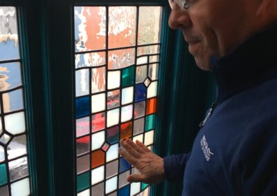 Participant admiring stained glass window