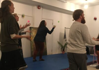 Participants trying their hand at juggling